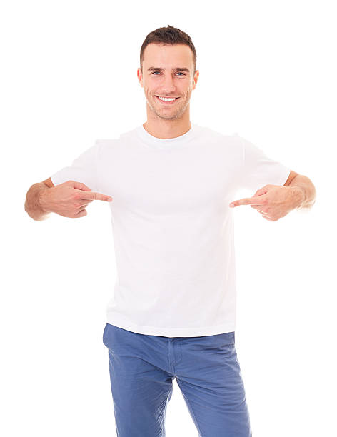 Man showing empty copyspace on white t shirt stock photo