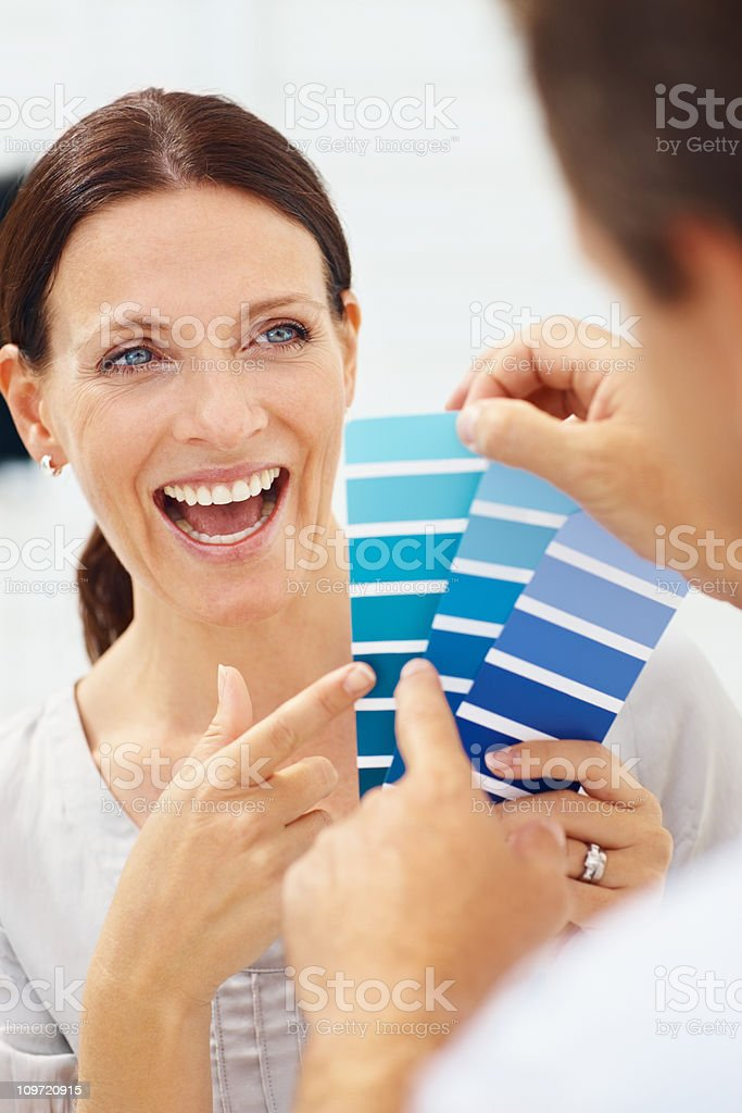 Man showing fabric swatches to his wife royalty-free stock photo