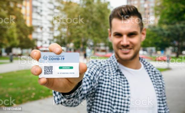 Man showing health passport indicating that he is immune to picture id1219134638?b=1&k=6&m=1219134638&s=612x612&h=m6e91woq43qui0q7ffzfvut8dtwffpr86kssn7memgw=