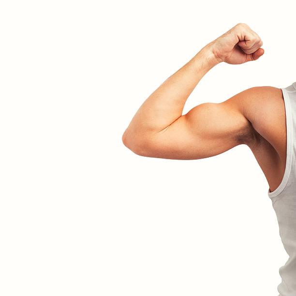 Man showing his biceps stock photo