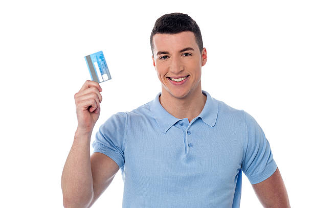 Man showing his credit card stock photo