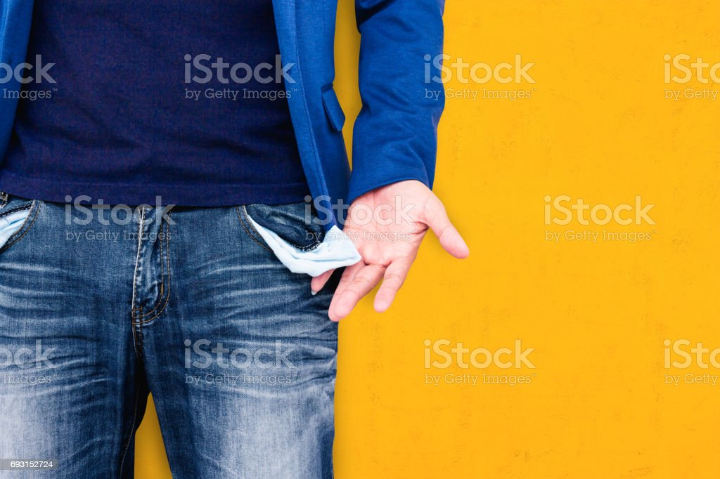 Man showing his empty pockets stock photo
