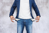 istock Man showing his empty pockets 695519852