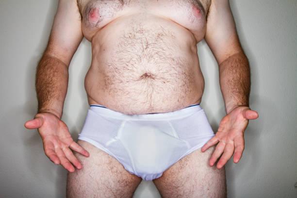 man zijn ongewenste pronken - penis stockfoto's en -beelden