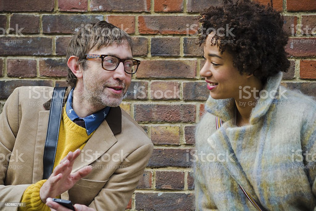 Man Showing His Phone To A Young Woman stock photo