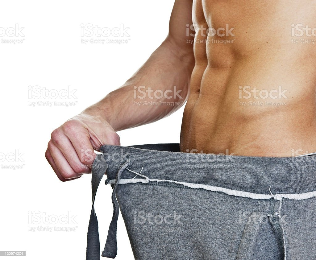 Man showing his weight loss royalty-free stock photo