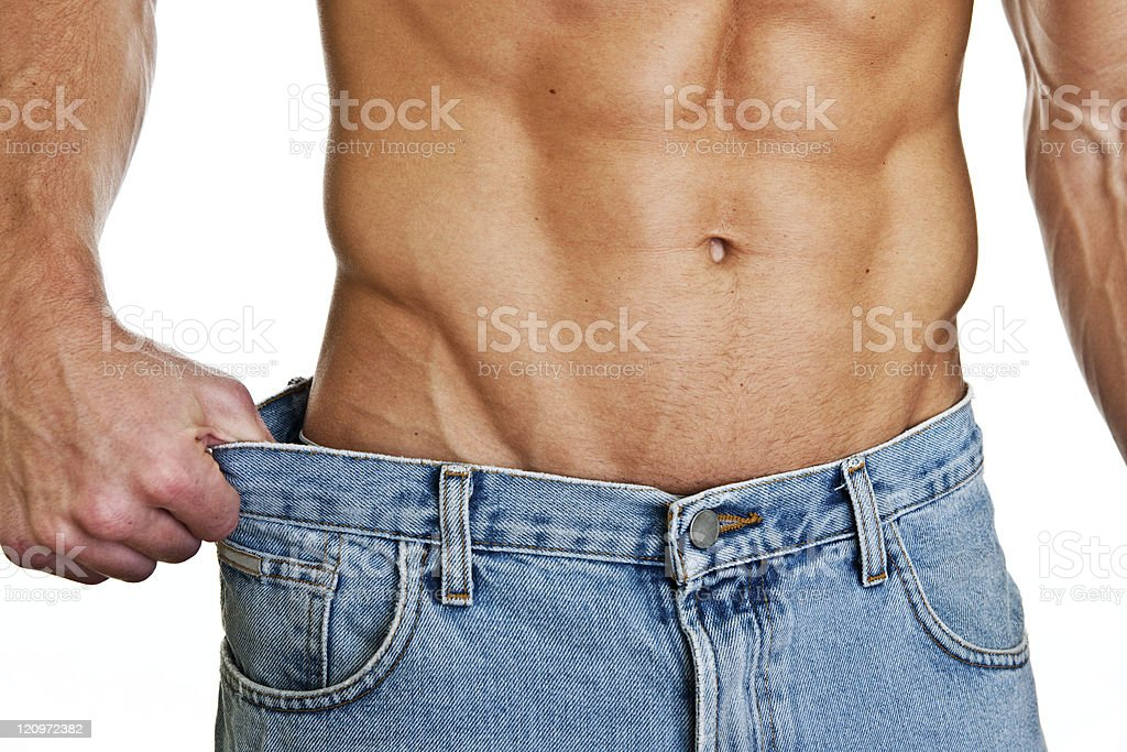 Man showing how much weight he lost royalty-free stock photo