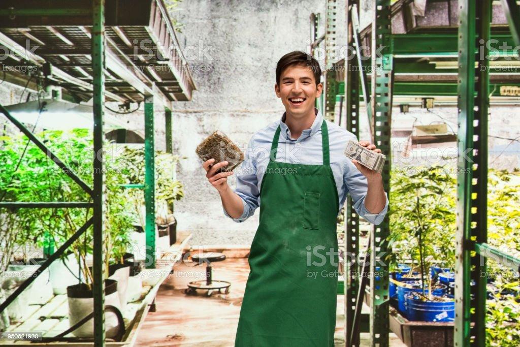 Man showing how profitable the marijuana business is