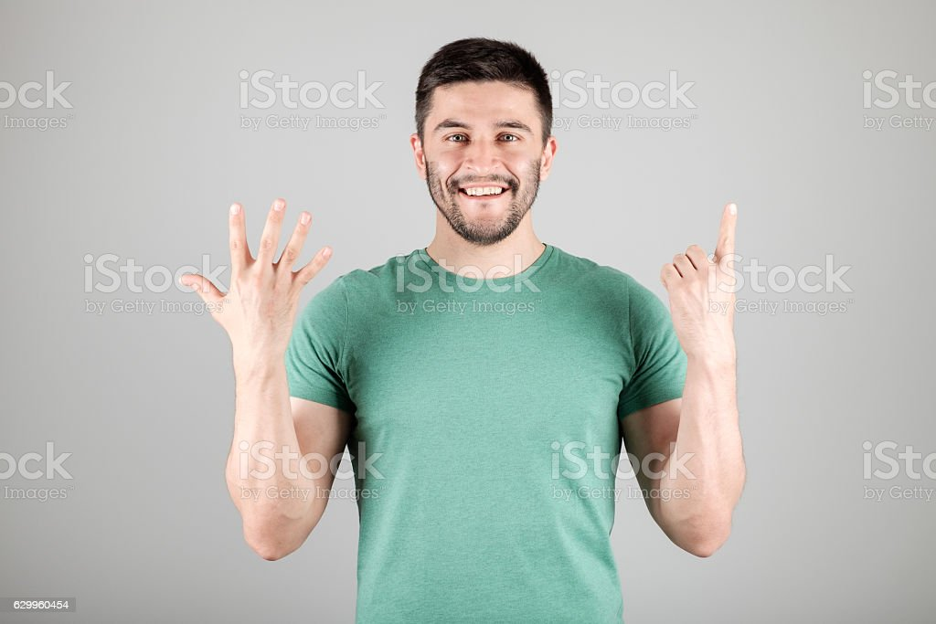 Man showing number by fingers stock photo