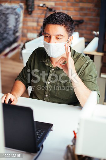 Man showing ok sign and wearing protection mask