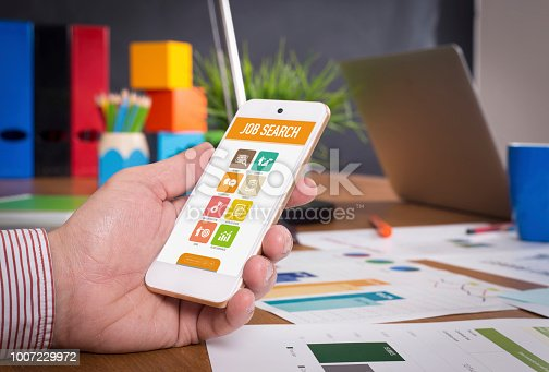 477419728istockphoto Man showing smartphone Job Search on screen 1007229972