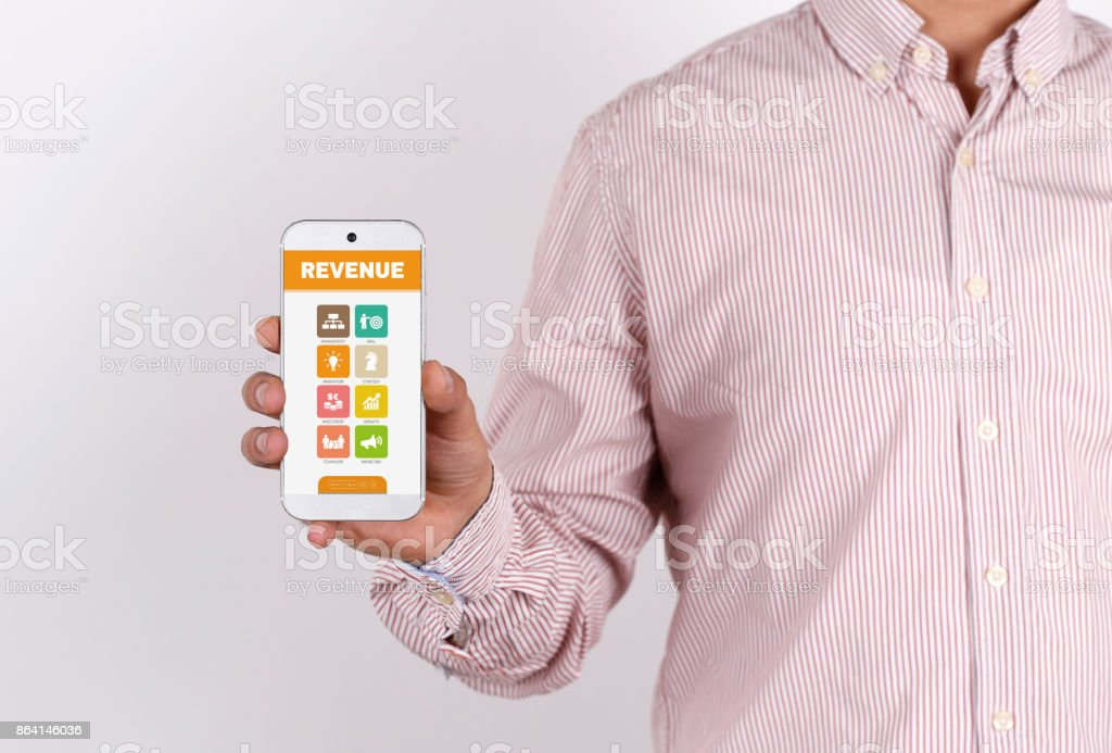 Man showing smartphone Revenue on screen royalty-free stock photo