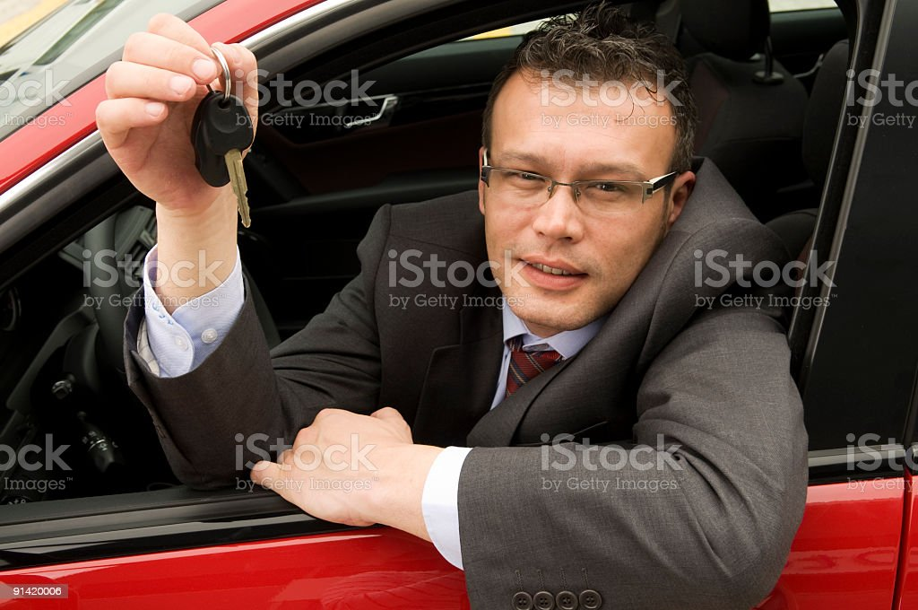 Man showing the car key royalty-free stock photo