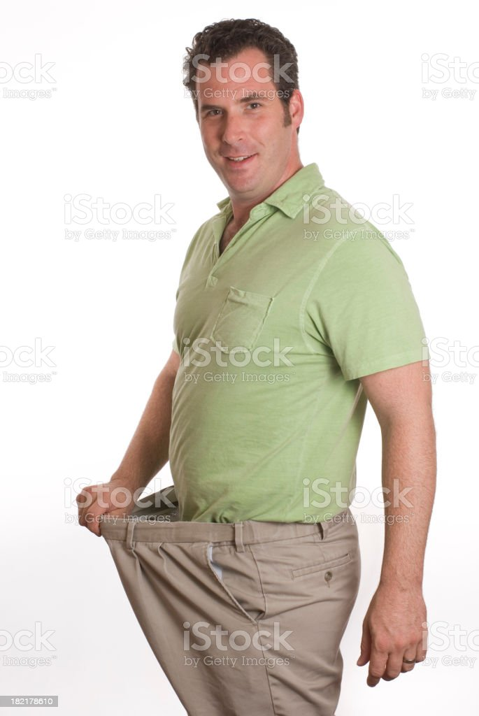 A man showing the weight loss success royalty-free stock photo