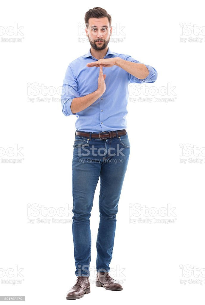 Man showing time out gesture stock photo