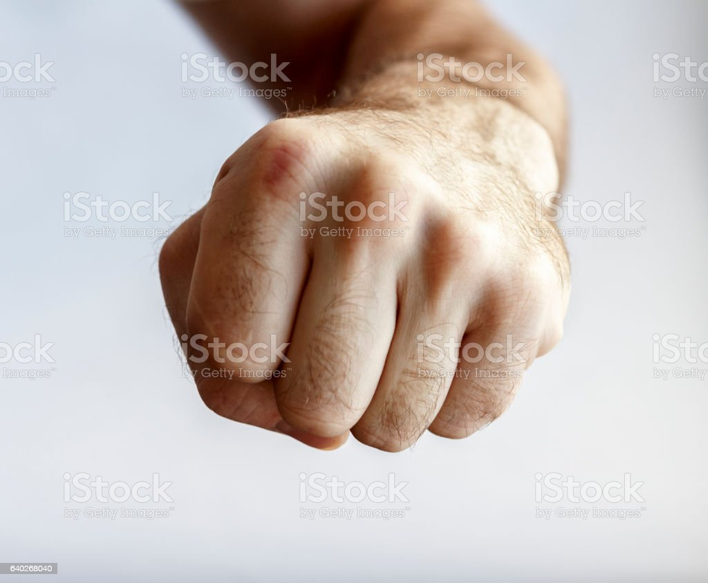 man shows a fist stock photo