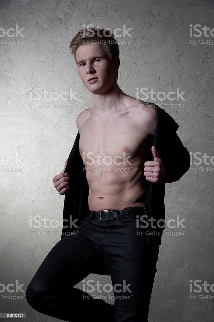 man shows torso stock photo