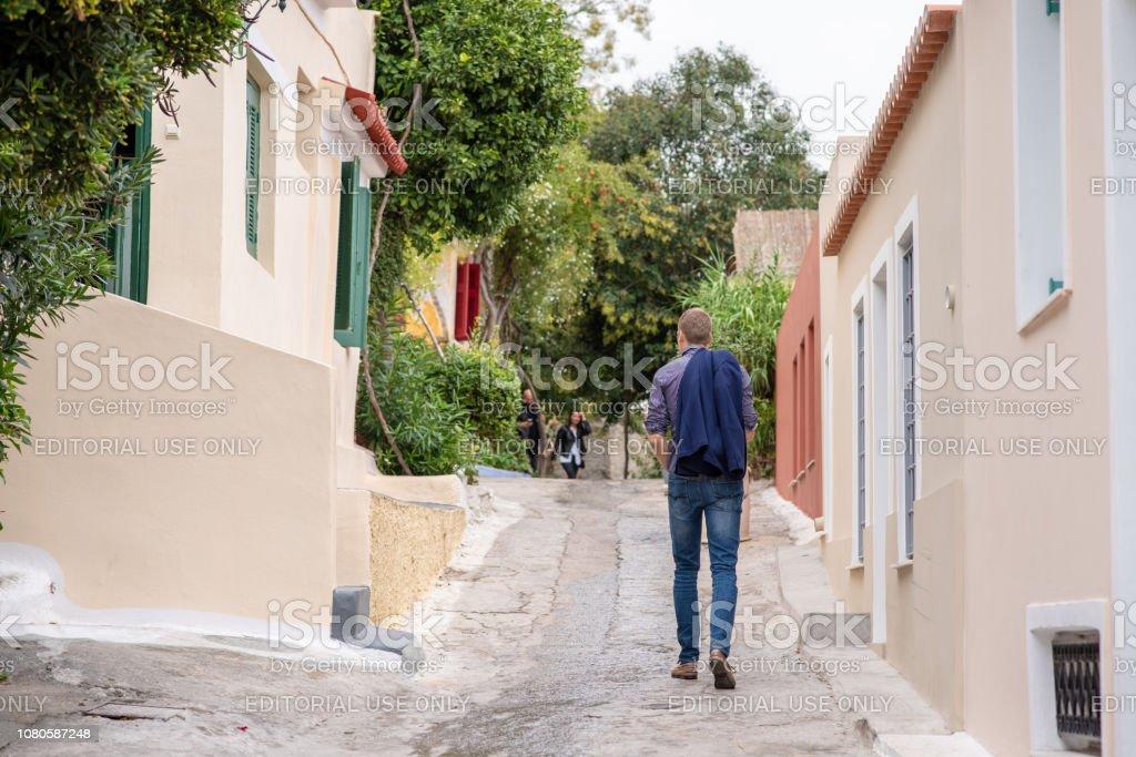 Man sightseeing in Anafiotika in Athens, Greece stock photo