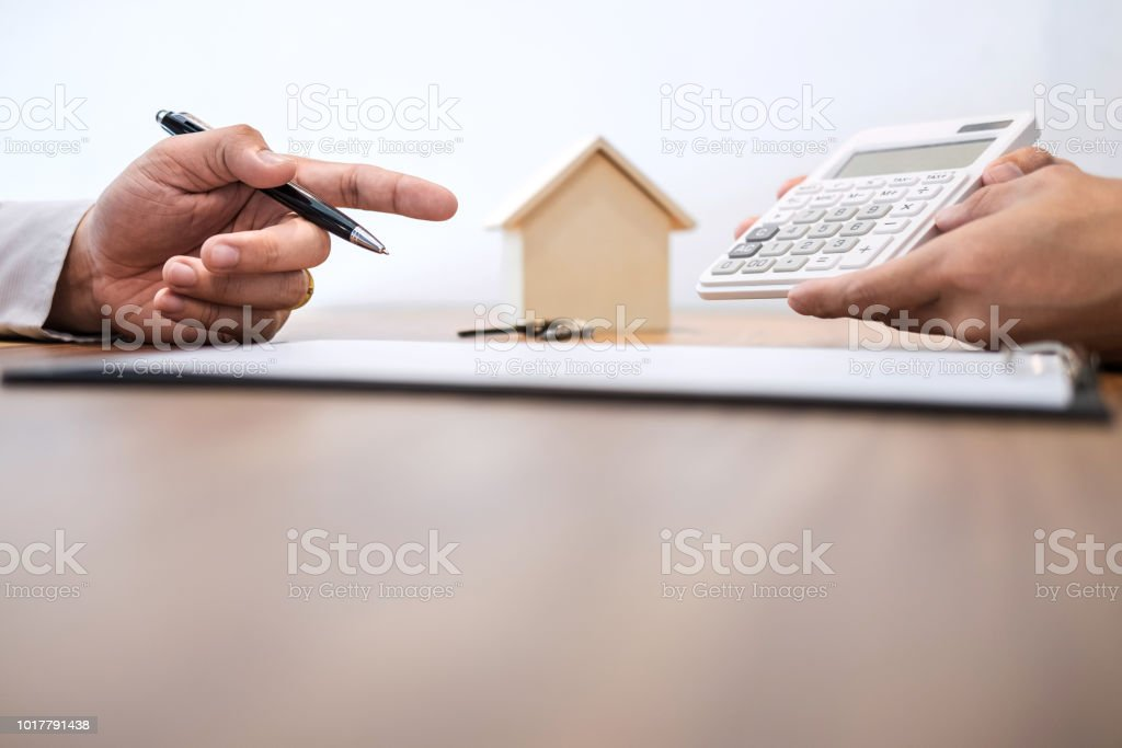 man sign a home insurance policy on home loans agent agent holds