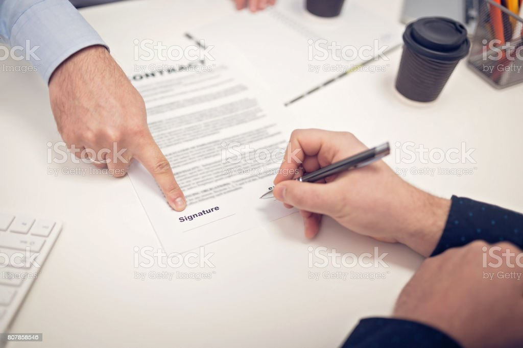 Man signed a contract stock photo