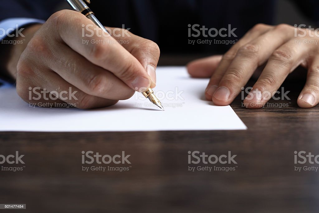 Man signing a document or writing correspondence stock photo
