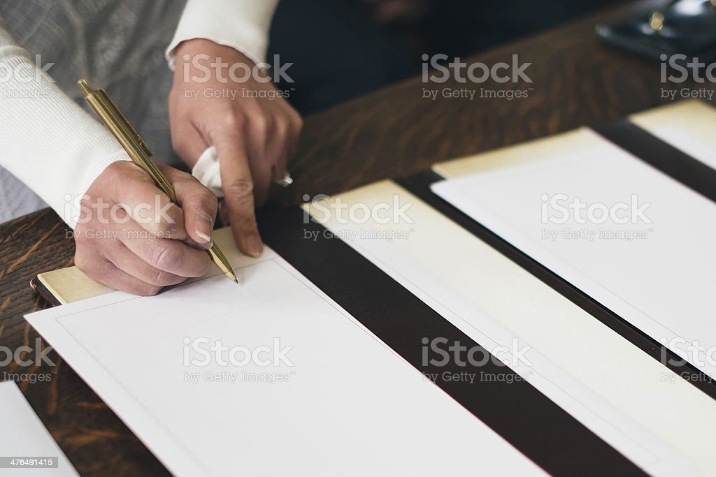 Man signing a document royalty-free stock photo