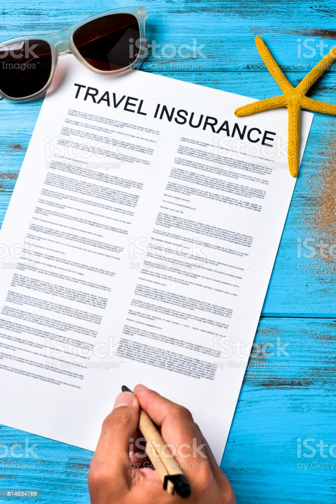 man signing a travel insurance contract stock photo