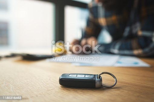 istock Man signing car insurance document or lease paper 1185316463