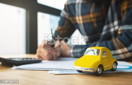 936987338 istock photo Man signing car insurance document or lease paper 1187151714