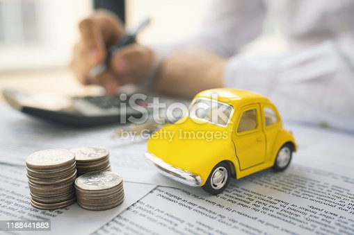 936987338 istock photo Man signing car insurance document or lease paper 1188441883