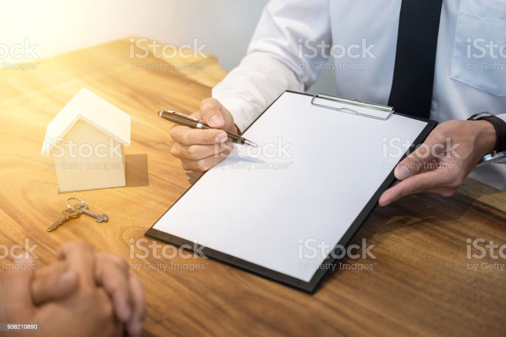 Man Signing Contract Of Loan Agreement Document With Bank Broker