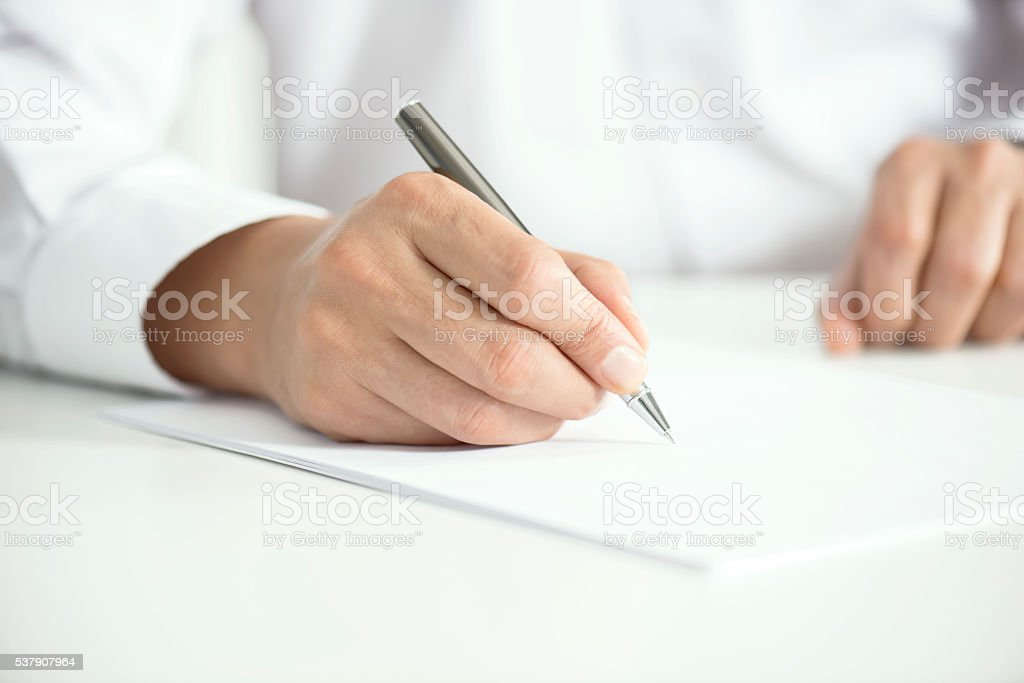Man Signing Contract Paper stock photo