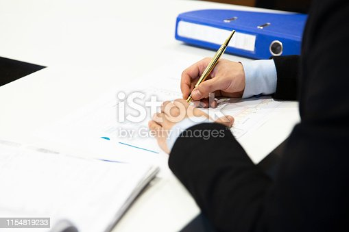 1072035844istockphoto Man signing contract 1154819233