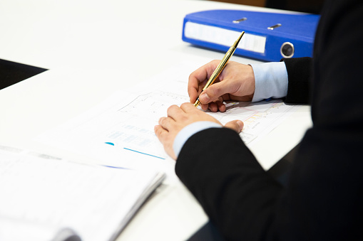 1072035844 istock photo Man signing contract 1154819233