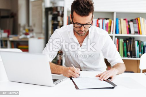 istock Man signing contract 451613245