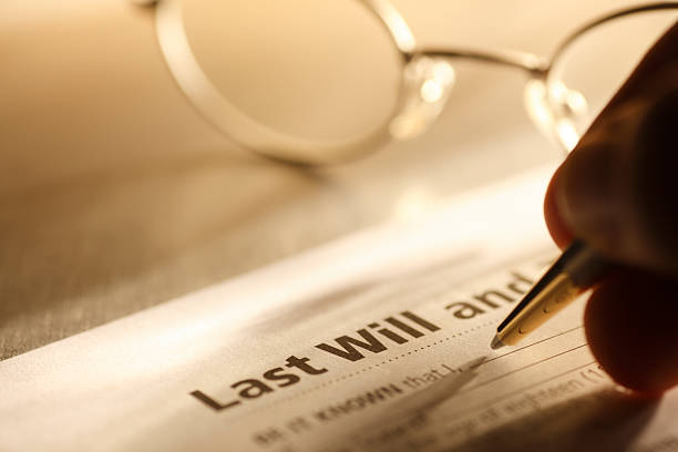 Man signing last will and testament stock photo
