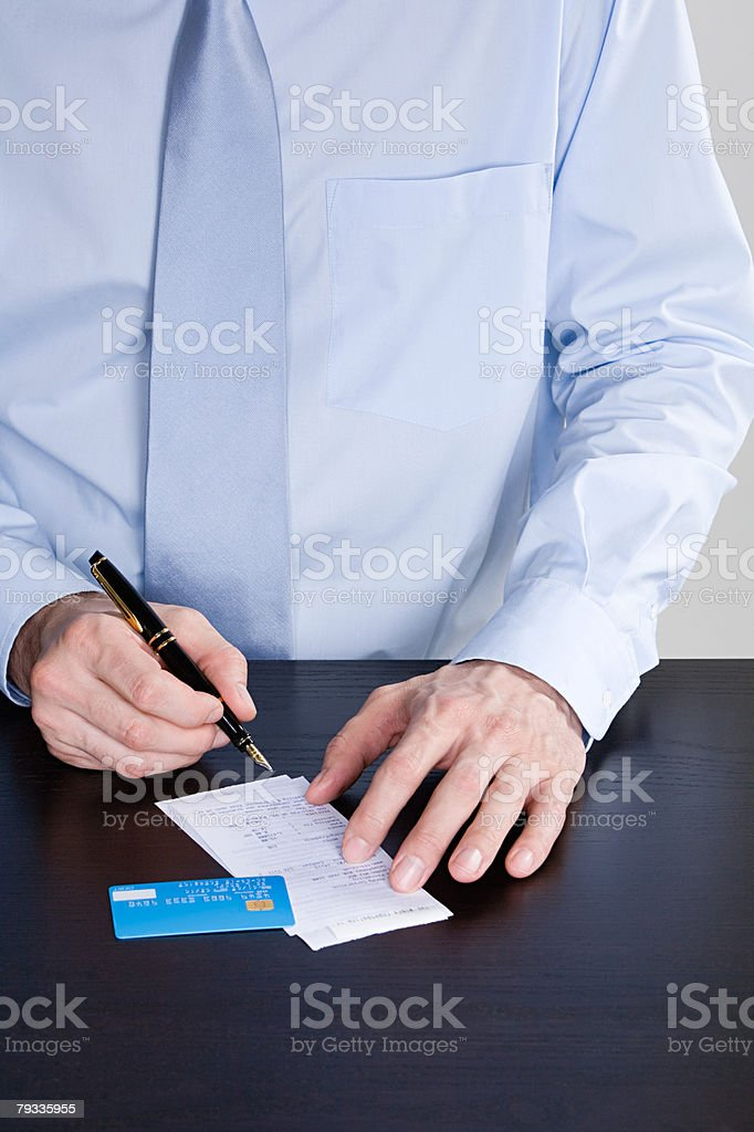 Man signing receipt 免版稅 stock photo