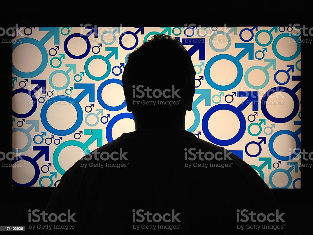 Man silhouette against male symbols stock photo