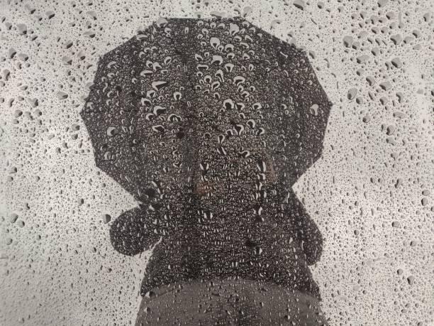 Man silhouette at the rain. stock photo