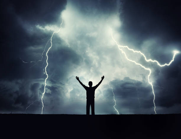 A man silhouette on a storm background. stock photo