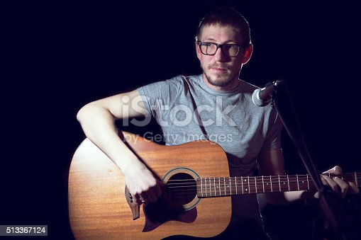 istock Man singer in plays guitar and sings. 513367124