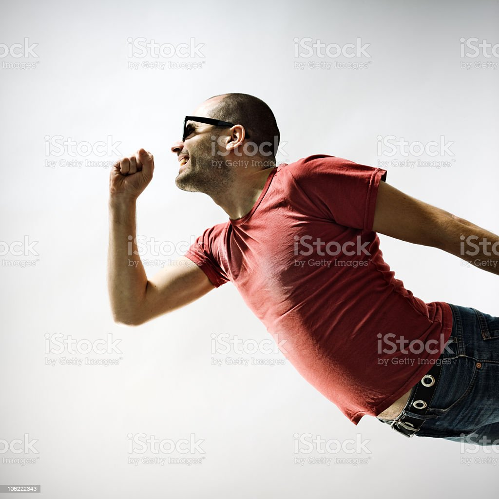Man Singing into air microphone stock photo
