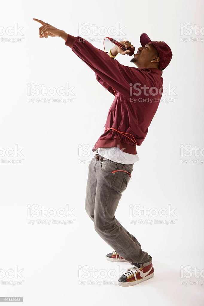 Man singing into microphone stock photo
