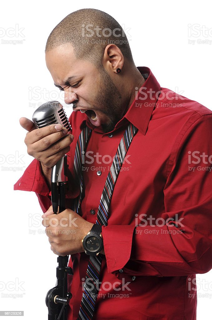 Man singing Into Vintage Microphone royalty-free stock photo