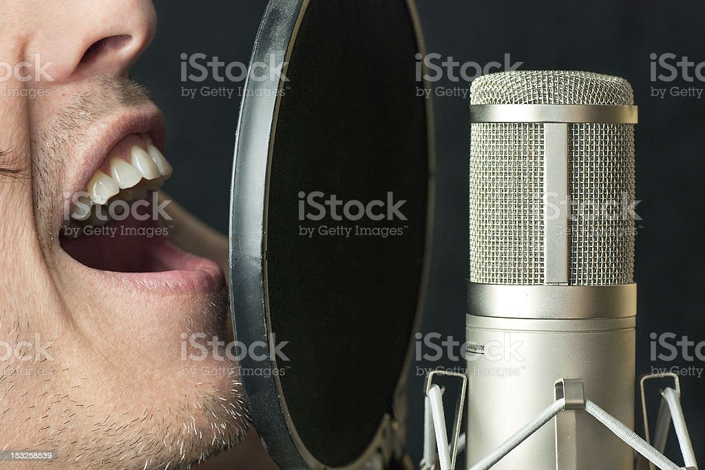 Man Sings Into Condenser Microphone, Close royalty-free stock photo