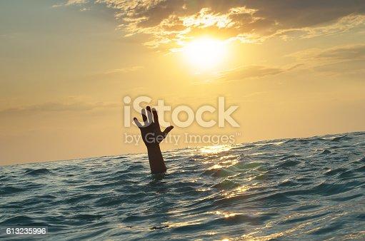 istock Man sink in water 613235996