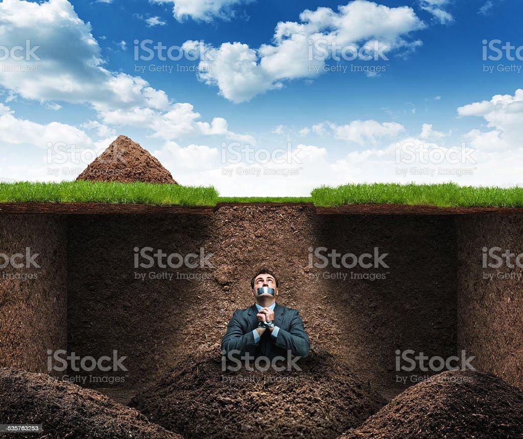 Man sits as hostage underground stock photo