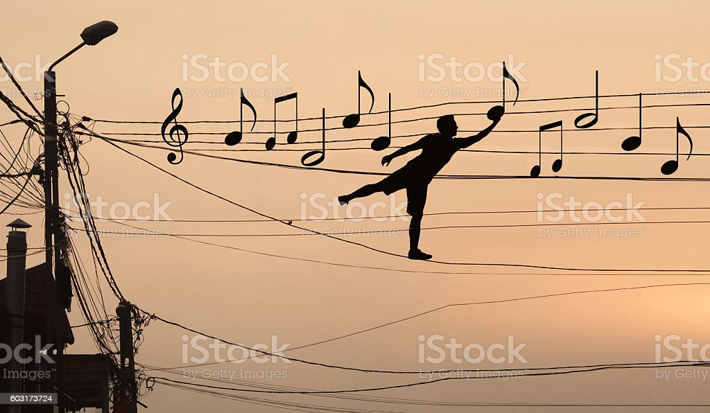 Man sits musical notes stock photo