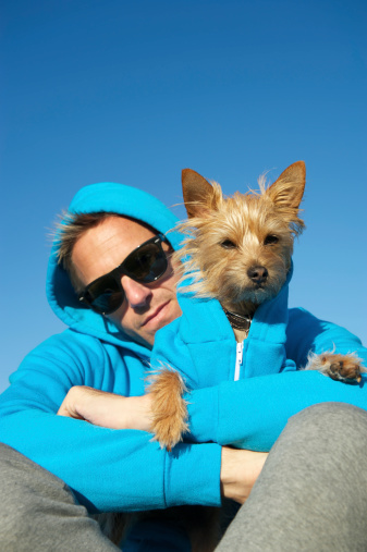 Man Sits with Dog in Matching Blue Hoody Sweatshirts