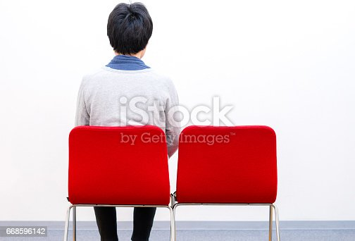 1125634038 istock photo Man sitting alone 668596142